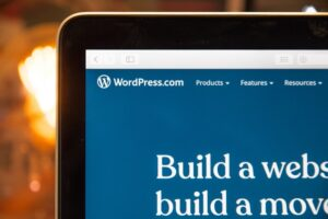 WordPress on a laptop which gives examples of content management system advantages.