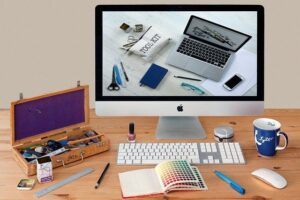 One of the great online business ideas is a graphic design agency depicted by these iMac and various design tools.