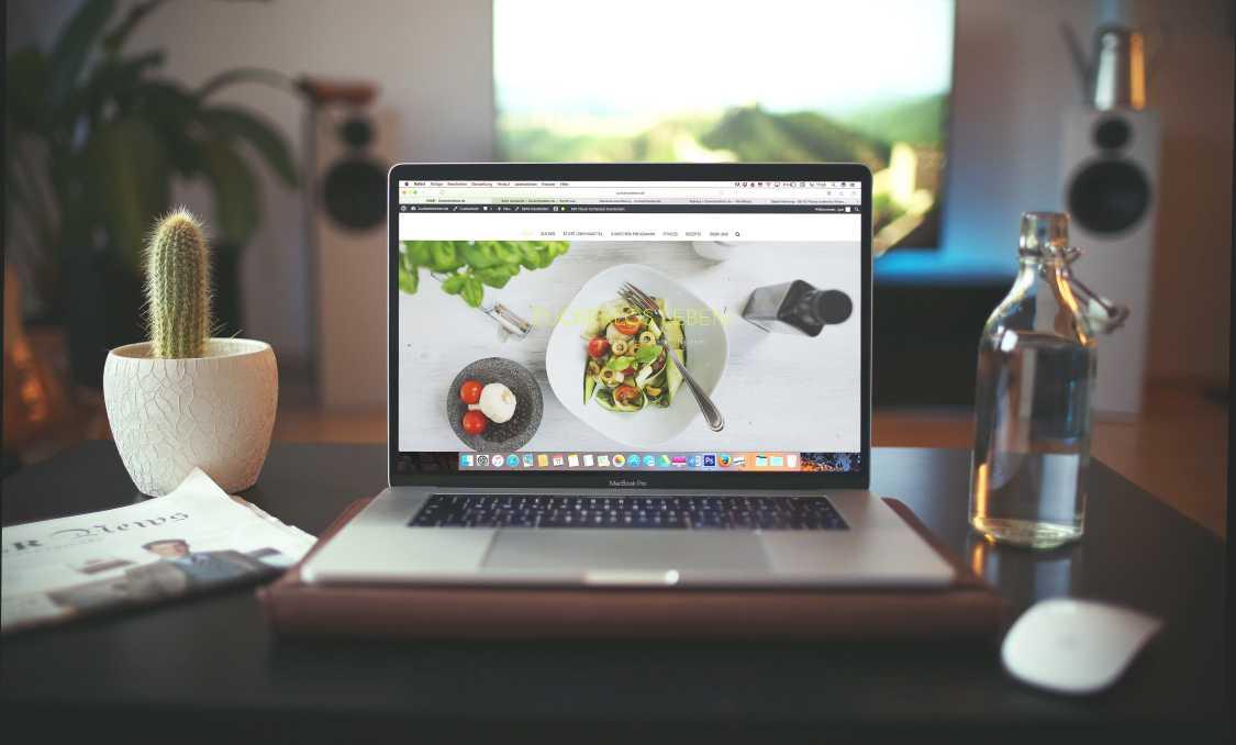 A professional website in a MacBook Pro in a desk.