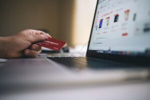 Man buying with his credit card on a store due to effective e-commerce marketing strategies.